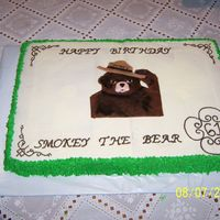 Smokey The Bear This cake was done for the local Forest Service District. They wanted a cake for Smokey's birthday! It's 2 11x15's, one...