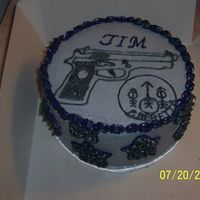 "Berreta Cake This is an 8"" double layer round Carrot Cake with crusting cream cheese icing and a Berreta Gun and logo. This was made for an..."