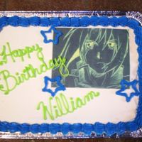 My Youngest Son's Birthday Cake chocolate and white ¼ sheet ice cream cake with butter cream frosting, edible image