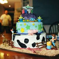 Toy Story Birthday Cake   Three tiers, butter-cream with fondant decorations and Disney figurines
