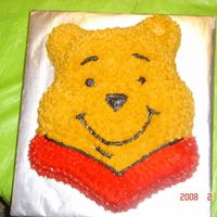 Winnie The Pooh Simple chocolate cake decorated with buttercream frosting.