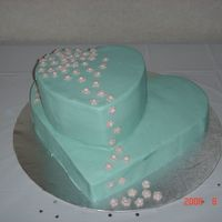 Heart Shaped Bridal Shower Cake Butter cake with chocolate filling. Decorated in buttercream with fondant cut outs.