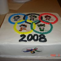 2008 Olympic Cake   white butter cream with rice paper mascots.