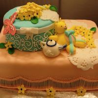 Baby Shower Cake Specialty cake using fondant for detail work. Everything is edible!