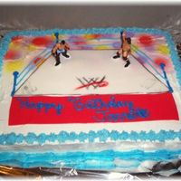 Wrestling Cake the cake was frosted with buttercream, the mat was done in fondant, the WWE on the ring was handpainted , the poles ropes were done with...