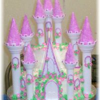 Princess Castle Cake 10 in double layer6 in double layer on top250 fondant flowers buttercream leaves to many to even think about lololRoyal Icing
