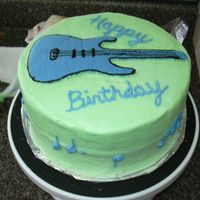 Guitar1.jpg Lemon pound cake (recipe from cake central) with frozen buttercream transfer of guitar. The music notes around the side are a bit hard to...