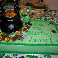 Leprechaun Cake  This is a half sheet with vanilla cake and vanilla SMBC filling and icing. The pot of gold is molded out of rice crispie treats and the...