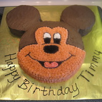 "Mickey Mouse 5Th Birthday Cake Head is 10"" yellow cake in a single layer, ears are each 6"" devil's food. Homemade Wilton Chocolate Buttercream covers the..."