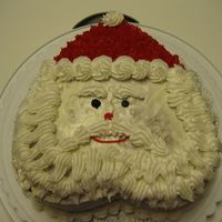 Santa Claus Cake Used Wilton medium heart pans. Duncan Hines Spice Cake with base coat of Duncan Hines cream cheese icing. Wilton-recipe buttercream used...