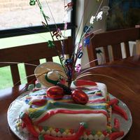 A Fiesta Party Cake  this was a mexican themed fiesta cake.Sugarpaste icing chillis, and accents, it was such a short notice cake or I would have made the...