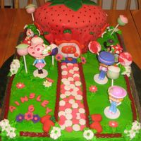 Strawberry Shortcake I want to thank Kassie73 for this cake design! My niece asked me to make her a strawberry shortcake cake including her hello kitty figure...