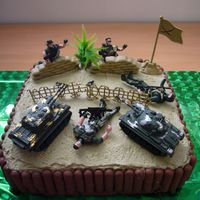 Army Figures Cake  I made this for a friends brothers birthday. He had just finished his army training. It's jam and cream filled chocolate cake, with BC...