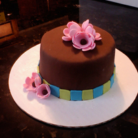 "Fondant Cake  I took a fondant class today at the White Flower cake shop. It's a 4"" cake that I covered in fondant and all flowers and..."