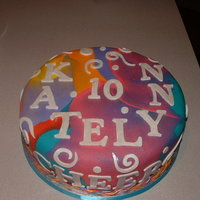 Tie Dye Swirl Birthday Cake This was such a fun cake to do for a girl who was turning 10. I just made up a few colors of fondant, swirled them together and rolled them...