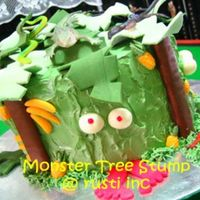 Monster Tree Two layer of vanilla sponge covered in buttercream. The leaves, pineapples, bananas, eyeballs and foot are all made from gumpaste.