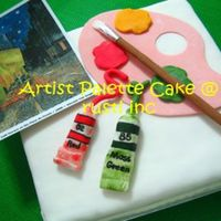Artist Palette   Walnut buttercake covered in white gumpaste to depict a blank canvas. Paintbrush, palette and paint tubes are all made with gumpaste.
