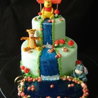Winnie The Pooh And His Friends IThis cake is so sweet! The characters were made by sugar and the second floor is false.