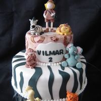 Vilmar's Safari All the jungle are represented in this cake. Monkey, elephant, girafe, zebra, lion and tiger were made with sugar paste.
