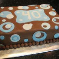 Blue Dots This is a small 2 layer sheet cake...peanut butter cake flavor w/ peanut butter filling. This was for my neighbors' husband's...