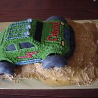 4 Wheelin' I made this cake using a VW Beetle pan for the car...all iced in buttercream. The tires were small doughnuts cut in half and covered in...