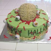 "Brains And Eyeballs This is a 10"" round cake covered in a mossy green icing. The brain on top was carved from a half ball pan and decorated with squiggly..."