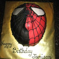 Spiderman Iii...two-Faced This cake was done for a boy who loved the third Spiderman movie where the Spiderman character turns from good (red faced) to bad (black...