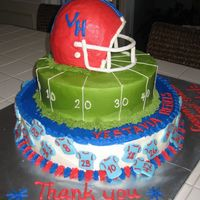 "Little League Football Team This was done for the end-of-season team party...for about 100 people. The helmet was carved from a 6"" round and a half ball pan. The..."