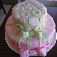 "Pink And Green Circles And Stripes This is a 2 tiered birthday cake I did for my 7 yr old daughter. Bottom tier is 10"" round and top is a 6"" round. All is covered..."