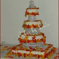 Jessica & Jake's Wedding Cake OK,bottom cake is two 1/2 sheetcakes, one chocolate, one yellow..next one up is white, then yellow on the last two cakes...It turned out...