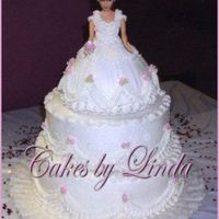 "Holly's Bride Doll Cake I did this for my daughter's bridal shower last yr. The layers are 12"" 10"" and a single layer 8"" under the doll cake it..."
