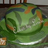 Camohatpost.jpg This is what I ended up with for the 12yr. old boy...He was thrilled.. My first MMF cake..Thanks for looking.