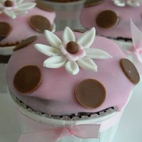 Pink Cupcake With Brown Pokadots Chocolate cupcake with pink poured fondant. for baby shower.