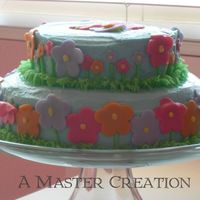 Flower Garden First 2 tiered cake. For my daughter's birthday party in her class. inspired by picture in wilton book.