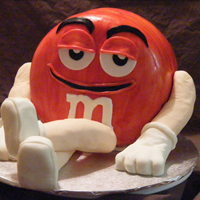 Red M&m  For my DS's b/d. He loves M&Ms and Red is his favorite character. Devil's Food Cake, White chocolate fondant, RKT arms and...