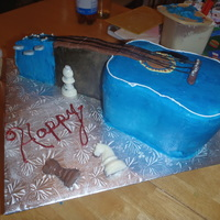 Blue Guitar  I made this for a guy turning 17, he's fatvorite thing is his acustic blue guitar. BC with fondant deco and cherry pie filling....