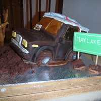 Mudpuppy  This is a birthday cake replica of the suzuki 4x4 truck of the birthday boy. He loves to off road and loose his muffler so I was asked to...