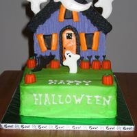Haunted House Halloween cake for a co-worker's daughter's school fundraiser. Vanilla cake w/ vanilla buttercream. I wanted to add more detail,...