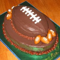Football Anyone? This is a Boston Cream Pie cake with little fondant footballs. Made for a client's son who is turning 14 this weekend.
