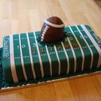 "Football Field Cake for my husbands flag football team. Two 8"" square cakes covered in fondant. Football was rice crispy treat covered with fondant...."