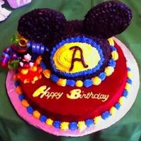 Mickey Mouse Club Birthday Buttercream base with buttercream details and mickey toys.