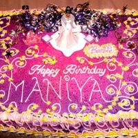 Barbie Birthday Cake Purple and hot pink sheet cake adorned with fantasy-like decorations