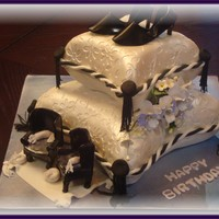 2 Tiered Pillow Cake With Shoes And Chairs I have been wanting to make a pillow cake for a while now and I finally gave it a try .. first time doing this type of cake. I used...
