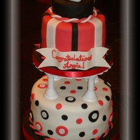 Red And Black Graduation 2 tiers in chocolate with chocolate buttercream (for chocolate lovers!); all covered and decorated with fondant. Hat & rolled diplomas...