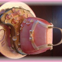 Pink Purse Cake This is my very first purse cake. The purse is made out of 6 thin layers of vanilla cake, filled with vanilla buttercream; the base of made...