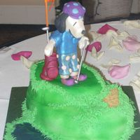 Golfing Snoopy Thanks to everyone that helped get me through this Snoopy cake! I wasn't happy with his face the first time around but after a few...