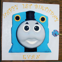 Thomas The Tank Engine Sheet cake for back of engine and then 3 x round cakes for face.