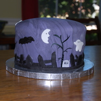 Spooky Graveyard Yellow cake covered with swirly purple/black fondant. Idea taken from this site.