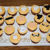 Halloween Cup Cakes Carrot cake cup cakes with orange frosting and halloween accents.