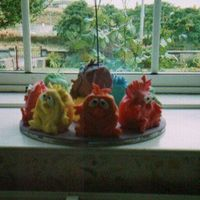 Monsters Sorry about the quality of the photo. Taken a few years ago. Wanted each child to go home with their special piece of cake so made them...